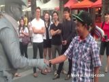 Man Punched By Street Performer