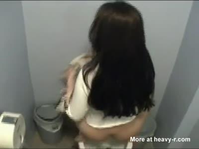 Sexy latina shitting atop of a toilet