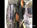 Woman pisses in shop