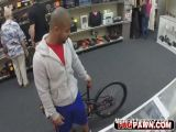 Black dude sell himself as a toy in a shop