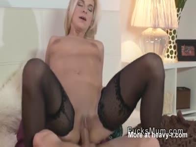 Blonde mature in black stockings fucks