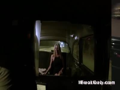 Blonde in orange panties in a cab