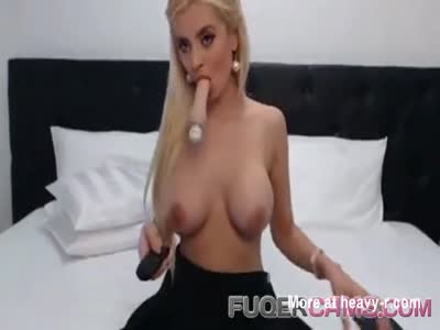 Blonde girl and sex toys in bed