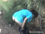 Girl caught pissing outside