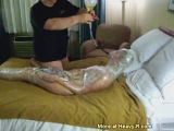 Wrapped up wife forced to drink piss