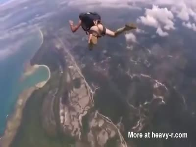 naked guy skydiving and filmed, his cock jiggling.